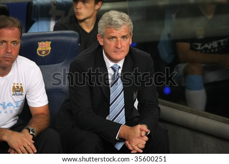 BARCELONA, SPAIN - AUG. 19: Manchester City welsh coach Mark Hughes during the match 44th Trophy Joan Gamper between FC Barcelona and Manchester City at Nou Camp Stadium in Barcelona, Spain. August 19, 2009.