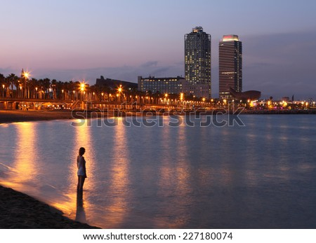 BARCELONA, SPAIN - AUGUST 15: Barceloneta beach and skyscrapers : Hotel Arts in the background on August 15, 2014 in Barcelona, Spain. The most famous view - stock photo