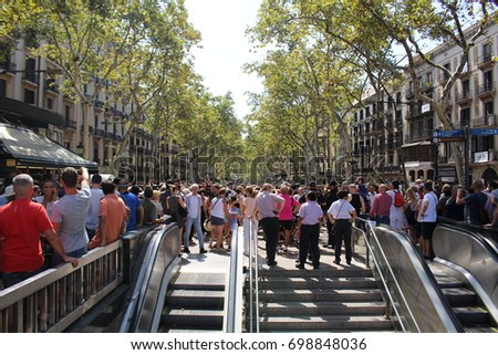 BARCELONA/SPAIN - 18 AUGUST 2017: Crowd on Barcelona's Rambla the day after the terrorist attack that left least 16 deadly victims and over 100 injured.  Credit: Dino Geromella / Shutterstock