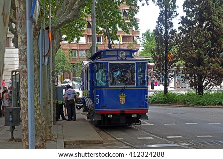 BARCELONA, SPAIN - AUGUST 1, 2015: Famous and one of the oldest in the world  streetcar Tramvia Blau in Barcelona, Spain - stock photo