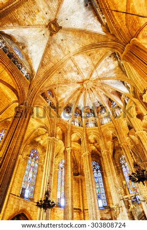 BARCELONA, SPAIN - AUGUST 21, 2014: Gothic arches in interior of the Cathedral of the Holy Cross and Saint Eulalia (Catedral de la Santa Cruz y Santa Eulalia), also known as the Barcelona Cathedral.