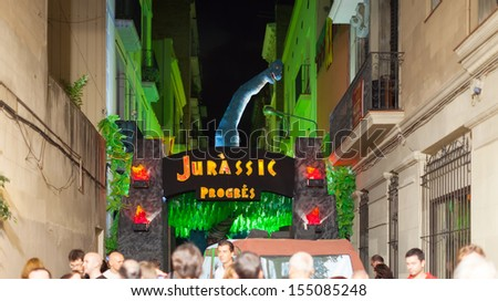 BARCELONA, SPAIN - AUGUST 15: Gracia Festival in night in August 15, 2013 in Barcelona, Spain. Each street is decorated with hand residents of the street