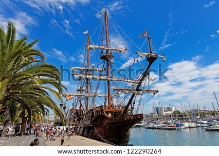 BARCELONA, SPAIN - AUGUST 07:Old frigate moored at Port Vell on August 07, 2012 in Barcelona, Spain. The area has a leisure center, shops and rest called Maremagnum, an IMAX cinema and an aquarium - stock photo