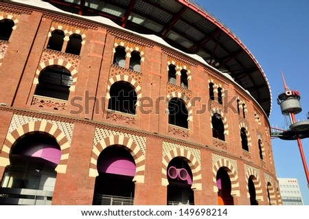 BARCELONA, SPAIN - AUGUST 06: Plaza de Espanya and Arenas bullring on August 06, 2013 in Barcelona, Spain. The old bullring, built in 1900, is since 2011 a shopping and leisure center  - stock photo