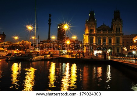 BARCELONA, SPAIN - AUGUST 20: Port Vell and Columbus Monument at night on August 20, 2013 in Barcelona, Spain. It is a 60 meters tall monument for Christopher Columbus at the lower end of La Rambla - stock photo