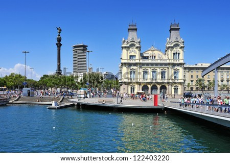 BARCELONA, SPAIN - AUGUST 16: Port Vell and Columbus Monument on August 16, 2012 in Barcelona, Spain. The monument is a 60 meters tall structure in honor of Christopher Columbus at end of La Rambla - stock photo