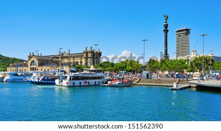 BARCELONA, SPAIN - AUGUST 16: Port Vell and Columbus Monument on August 16, 2012 in Barcelona, Spain. It is a 60 meters tall monument for Christopher Columbus at the lower end of La Rambla - stock photo