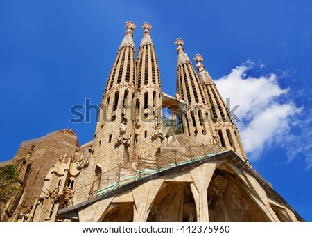 BARCELONA, SPAIN - AUGUST 14, 2011: Steeples of Sagrada Familia in Barcelona in Spain. It is called in English as Basilica and Expiatory Church of Holy Family. It was designed by Antoni Gaudi - stock photo