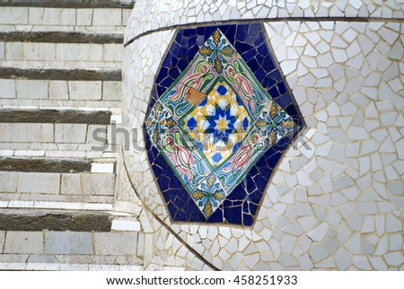 BARCELONA, SPAIN - CIRCA OCTOBER 2013: Tile mosaic decorations beside a staircase in Park Guell