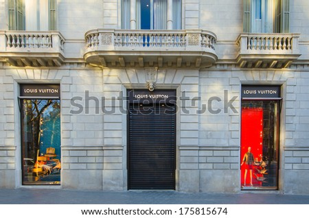 BARCELONA, SPAIN - DEC 29: Louis Vuitton store on the  street Passeig de Gracia in Barcelona. A shopping district. December 29, 2013. - stock photo