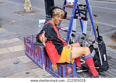 BARCELONA, SPAIN - DEC 20: The Ronaldinho of La Rambla, performs at Les Rambles street on December 20, 2009 in Barcelona, Spain. Especially known for its fountains and statues. - stock photo