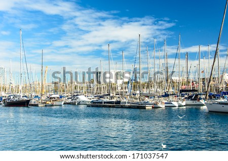 BARCELONA, SPAIN - DEC 28: Yachts at the dock port vell Barcelona, Spain on December 28, 2013