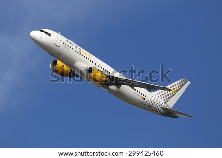 BARCELONA, SPAIN - DECEMBER 12:  A Vueling Airbus A320 taking off from on December 12, 2014 in Barcelona. Vueling is a spanish low-cost airline with its headquarters near Barcelona. - stock photo