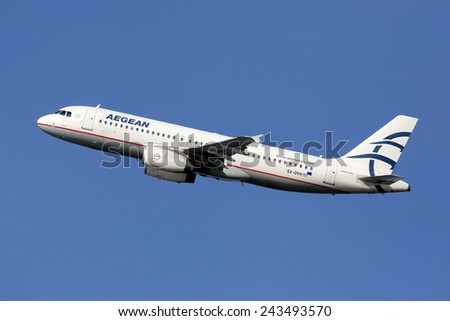 BARCELONA, SPAIN - DECEMBER 12:  An Aegean Airbus A320 taking off on December 12, 2014 in Barcelona. Aegean is an airline from Greece with its headquarters in Athens and some 36 planes in operation. - stock photo