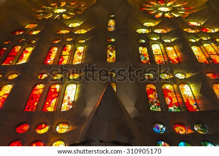 BARCELONA, SPAIN - DECEMBER 22, 2014: Detail of the interior of the church of La Sagrada Familia, designed by Gaudi, where you can see the new lighting. - stock photo