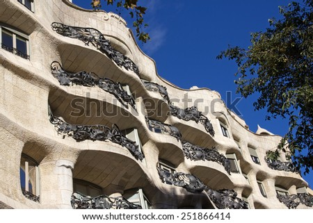BARCELONA, SPAIN - DECEMBER 7: Facade of the Casa Mila by Antoni Gaudi in Barcelona on December 7, 2014. Casa Mila is of modernist style, also a UNESCO site. - stock photo