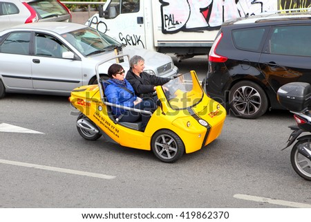 BARCELONA, SPAIN - december 12, 2015: GoCar in the streets of Barcelona. GoCar is a two-seater, 3 wheeled vehicle for the purpose of being rented to tourists as a different way to see a city - stock photo