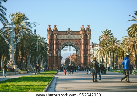 BARCELONA, SPAIN - DECEMBER 26, 2015: Many tourists near the Arc de Triomphe in sunny winter day