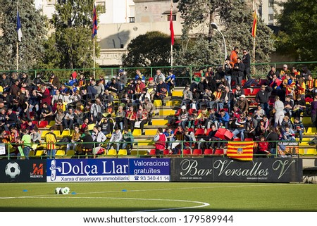 BARCELONA, SPAIN - DECEMBER 7: Unidentified supporters at Spanish Cup match between Sant Andreu and Atletico de Madrid, final score 0-4, on December 7, 2013, in Barcelona, Spain. - stock photo