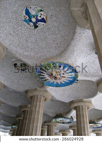 BARCELONA, SPAIN - DECEMBER 16, 2009: view of the columns and mosaic ceiling at the Park Guell, architectural landmark designed by the famous architect Antonio Gaudi