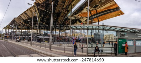 BARCELONA, SPAIN - FEB 8, 2014: Famous flea market Els Encants Vells with mirror ceiling reflected buyers sellers and stalls in Barcelona Spain on Feb 8, 2014.  - stock photo
