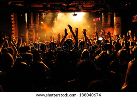 BARCELONA, SPAIN - FEB 21: People from the crowd (fans) applauding a concert by Bombay Bicycle Club (band) at Bikini Club on February 21, 2014 in Barcelona, Spain. - stock photo