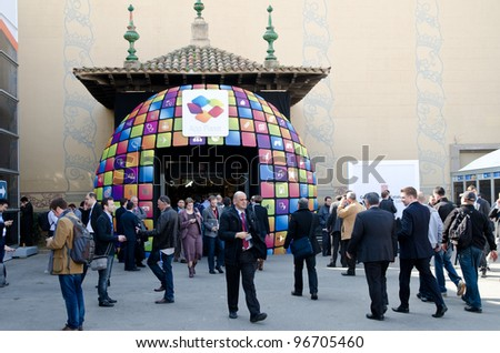BARCELONA, SPAIN - FEB 26: Visitors of the GSMA Mobile World Congress 2012 in front of the App Planet exhibition hall on Feb 26, 2012 in Barcelona, Spain - stock photo