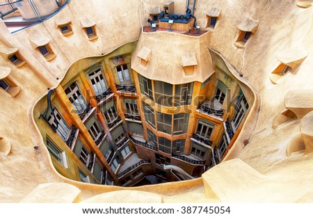 BARCELONA, SPAIN - FEBRUARY 9, 2016: Closeup of Casa Mila (La Pedrera) in Barcelona, Catalonia. House was built in 1905 to 1910 by Catalan architect Antoni Gaudi. - stock photo