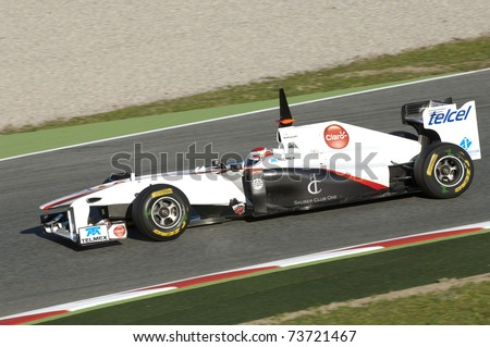 BARCELONA, SPAIN - FEBRUARY 18: Kamui Kobayashi drives for the Sauber F1 Team during testing at the Circuit de Catalunya February 18, 2011 in Barcelona, Spain.