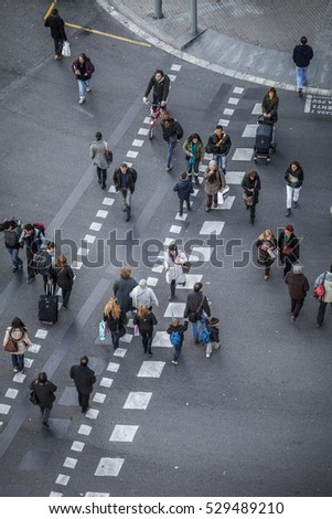 Barcelona, Spain - February 16, 2012: pedestrians in a weekleday in the capital of Catalonia