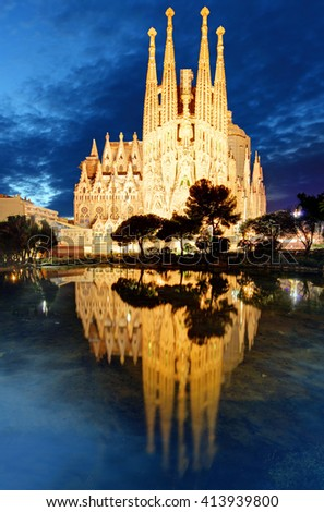 BARCELONA, SPAIN - FEBRUARY 8: Sagrada Familia at night on February 8, 2016 in Barcelona, Spain. The impressive cathedral designed by Antoni Gaudi is being built since 1882 and is not finished yet - stock photo