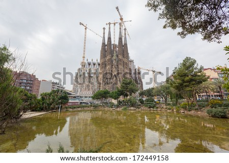 BARCELONA, SPAIN - FEBRUARY 27: Sagrada Familia on a Sunny Day on February 27, 2013 in Barcelona, Spain. Designed by Antoni Gauda, the church is still incomplete. - stock photo