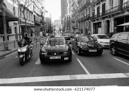 BARCELONA,SPAIN - February 26,2017: Shot of Plaça de Catalunya street  in Barcelona, Spain. This image may contain noise ,blurry clouds due to long exposure, soft focus and poor lighting.