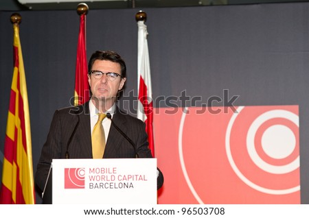 BARCELONA, SPAIN - FEBRUARY 26: The Minister for Industry, Tourism and Commerce, Jose Manuel Soria speaks at the official inauguration act at the MWC 2012 on February 26, 2012 in Barcelona, Spain - stock photo