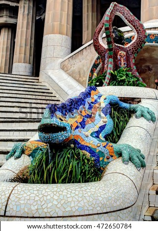 "BARCELONA - SPAIN / 01.04.2013: Gaudi's multicolored mosaic salamander, popularly known as ""el drac"" (the dragon), at the main entrance of the Park Guell"