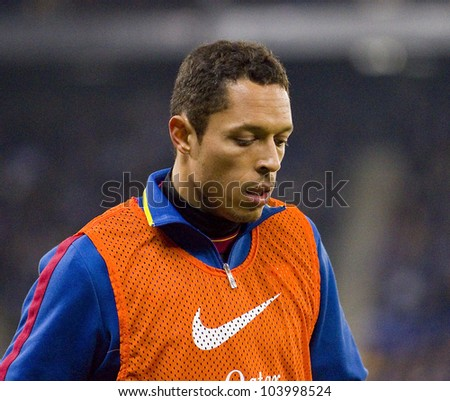 BARCELONA, SPAIN - JANUARY 8: Adriano Correia of Barcelona in action during the Spanish league match between RCD Espanyol and FC Barcelona, final score 1-1, on January 8, 2012, in Barcelona, Spain.