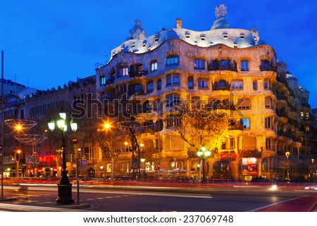 BARCELONA, SPAIN - JANUARY 2, 2014: Night view of Casa Mila (La Pedrera) in Barcelona.  House was built in 1905-1910 by Antoni Gaudi   - stock photo