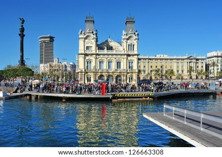 BARCELONA, SPAIN - JANUARY 26: Port Vell and Columbus Monument on January 26, 2013 in Barcelona, Spain. The monument is a 60 meters tall structure in honor of Christopher Columbus at end of La Rambla - stock photo
