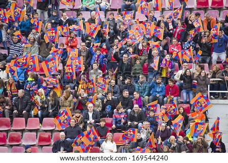 BARCELONA, SPAIN - JANUARY 3: Some supporters at FC Barcelona team in open doors training session at Mini Estadi stadium, with 13,200 spectators, on January 3, 2014, in Barcelona, Spain. - stock photo