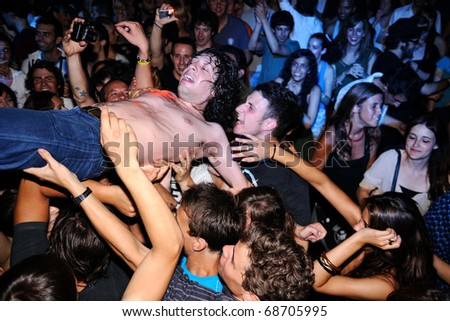 BARCELONA, SPAIN - JULY 23: Adam Green performs at Discotheque Razzmatazz on July 23, 2010 in Barcelona, Spain. Jumps over the public several times. - stock photo