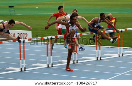 BARCELONA, SPAIN - JULY 12: athletes compete in the 110 meters final on the 2012 IAAF World Junior Athletics Championships on July 12, 2012 in Barcelona, Spain.