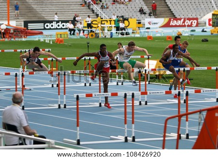BARCELONA, SPAIN - JULY 12: athletes compete in the 110 meters final on the 2012 IAAF World Junior Athletics Championships on July 12, 2012 in Barcelona, Spain. - stock photo