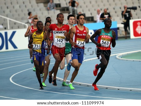 BARCELONA, SPAIN - JULY 14: athletes compete in the 800 meters semi - final on the 2012 IAAF World Junior Athletics Championships on July 14, 2012 in Barcelona, Spain. - stock photo