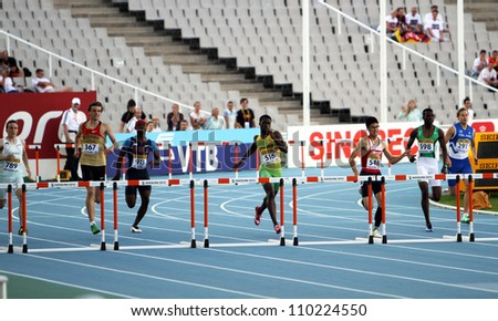 BARCELONA, SPAIN - JULY 13: Athletes in the 400 meters hurdles final on the 2012 IAAF World Junior Athletics Championships on July 13, 2012 in Barcelona, Spain - stock photo