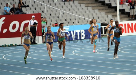 BARCELONA, SPAIN - JULY 14: athlets compete in the 400 meters race on the 2012 IAAF World Junior Athletics Championships on July 14, 2012 in Barcelona, Spain. - stock photo