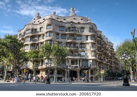 BARCELONA, SPAIN - JULY 28: Casa Mila (La Pedrera) in Eixample, Barcelona on July 28, 2012. Casa Mila, an aristocratic apartment building, is one of Antoni Gaudi's most famous works.  - stock photo