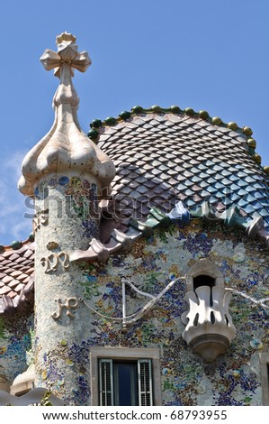BARCELONA, SPAIN - 25 JULY, 2010: Exterior of Casa Batllo on July 25, 2010, a famous tourist destination restored by catalan architect Antoni Gaudi. Gaudi  decorated the facade with mosaic tiles. - stock photo