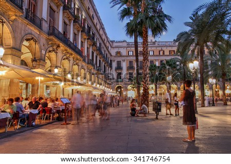 BARCELONA, SPAIN - JULY  30: Placa Reial (Royal Plaza), one of the most lively squares in Barcelona, Spain on July 30, 2012. It is located in the Barri Gothic quarter, close to Las Ramblas. - stock photo