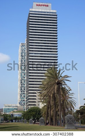 BARCELONA, SPAIN - JULY 12, 2015: Skyscraper Torre Mapfre in the Olympic Port. It is named after its owner, Mapfre, an insurance company.