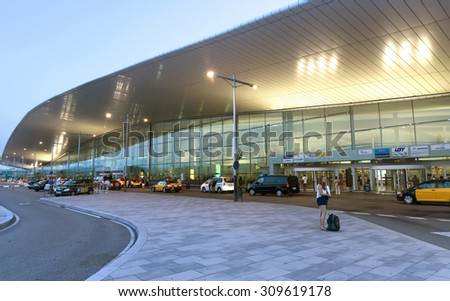 BARCELONA, SPAIN - JULY 16, 2015: Terminal T1 of El Prat-Barcelona airport. This airport was inaugurated in 1963. Airport is one of the biggest in Europe. - stock photo